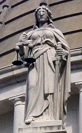 Themis armed with sword and balance scales (Court of Final Appeal, Victoria, Hong Kong)